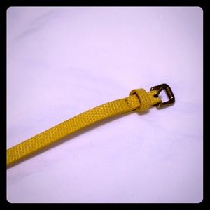 Thin yellow belt with snake print embossed. Size S